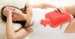 Woman stomach ache period hot water bottle