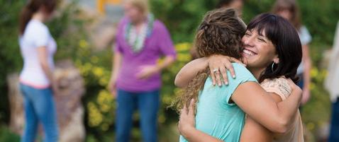 Women hugging at womens ministry